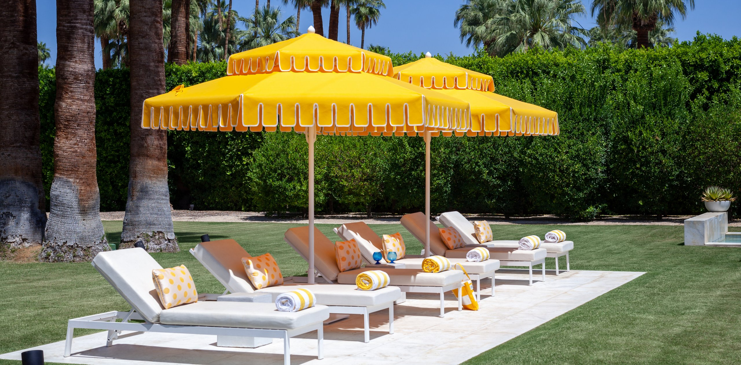 Image of umbrellas and chaises poolside